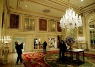 Tourists take photos in the foyer of the Plaza Hotel in New York City. Flamboyant Indian billionaire Subrata Roy has finalised the purchase of New York's landmark Plaza Hotel for $575 mn, it was announced Wednesday