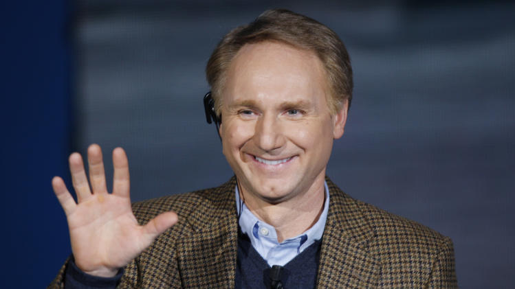 "FILE - In this Dec. 6, 2009 file photo, writer Dan Brown, author of ""The Da Vinci Code,"" waves as he appears on the Italian State RAI TV program ""Che Tempo che Fa"", in Milan, Italy. Brown on Friday, May 18, 2012 made a rare public appearance in Portsmouth, N.H., sharing stories about writing, movie-making, science, religion, and more. The author, who grew up in New Hampshire, spoke at a benefit for The Music Hall's ""Writers on a New England Stage"" series. (AP Photo/Luca Bruno)"