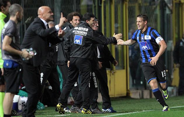 Atalanta's German Denis, right, of Argentina, celebrates after scoring during a Serie A soccer match against Inter Milan in Bergamo, Italy, Tuesday, Oct. 29, 2013