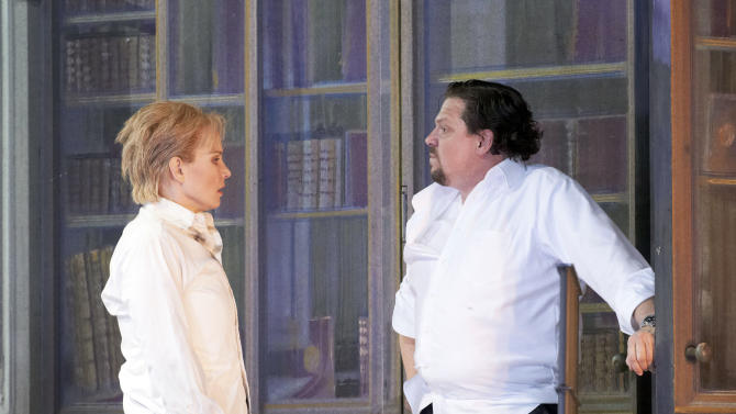 """In this photo taken Monday, May 7, 2012, Elina Garanca in the role of Sesto and Michael Schade as Tito, from left, perform during a dress rehearsal for the opera """"La Clemenza di Tito"""" by Wolfgang Amadeus Mozart at the State Opera in Vienna, Austria. (AP Photo/Wiener Staatsoper/Michael Poehn)"""