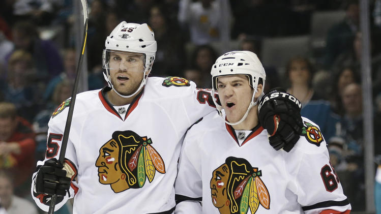 Chicago Blackhawks center Andrew Shaw, right, celebrates with Viktor Stalberg, of Sweden, after Shaw's goal against the San Jose Sharks during the first period of an NHL hockey game in San Jose, Calif., Tuesday, Feb. 5, 2013. (AP Photo/Marcio Jose Sanchez)