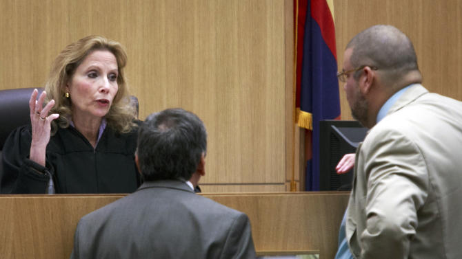 Superior Court Judge Sherry Stephens speak with defense attorney Kirk Nurmi, right, and prosecutor Juan Martinez, left, during the trial of Jodi Arias at the Maricopa County Superior Court on Tuesday, Jan. 15, 2013, in Phoenix. Arias is charged with murder in the death of her boyfriend, Travis Alexander, and prosecution is seeking the death penalty.(AP Photo/The Arizona Republic, Charlie Leight)
