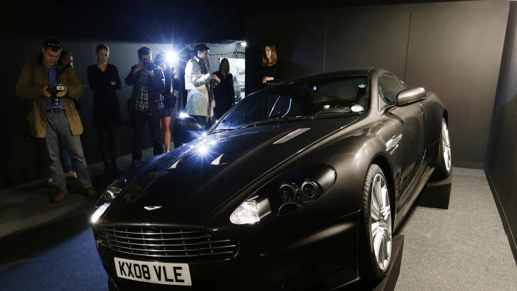 The 2008 Aston Martin 6 litre V12 DBS 2 door coupe used by Daniel Craig as James Bond in the movie 'Quantum of Solace' is shown to the media during a press preview at the James Bond movie memorabilia charity auction at Christie's auction house in London, Friday, Sept. 28, 2012. The car is expected to sell for some 100,000 -150,000 British pounds ($160-230,000 euro 120-170,00) with the proceeds going to the British children's charity Barnardo's.  (AP Photo/Alastair Grant)