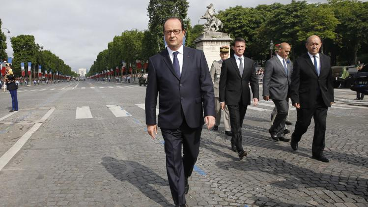 French President Francois Hollande and Prime Minister Manuel Valls arrive to attend the traditional Bastille Day parade on the Place de la Concorde in Paris