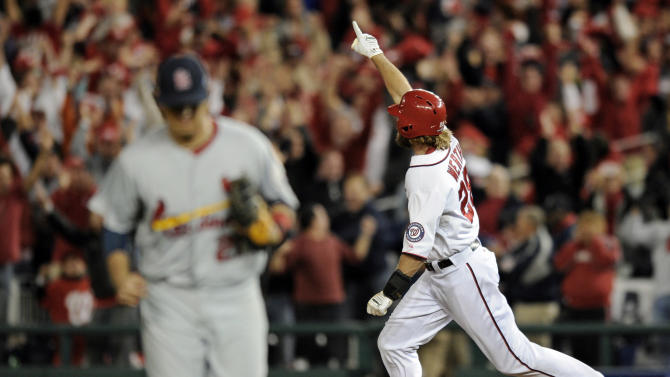 Washington Nationals' Jayson Werth, right, reacts as he rounds the bases after hitting the game-winning solo home run in the ninth inning of Game 4 of the National League division baseball series against the St. Louis Cardinals on Thursday, Oct. 11, 2012, in Washington. Washington won 2-1. (AP Photo/Nick Wass)