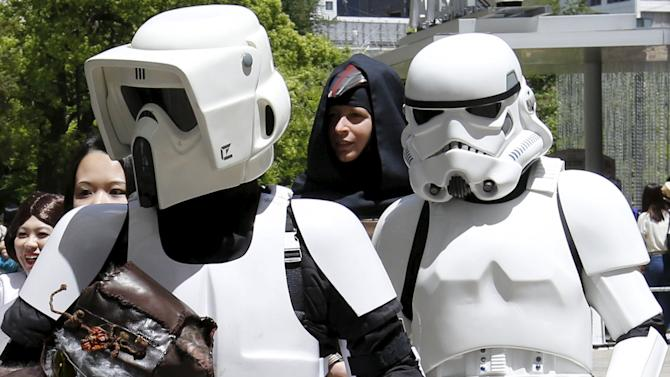 """Cosplayers dressed up as """"Star Wars"""" characters Scout Trooper and Storm Trooper take part in a Star Wars Day fan event in Tokyo"""