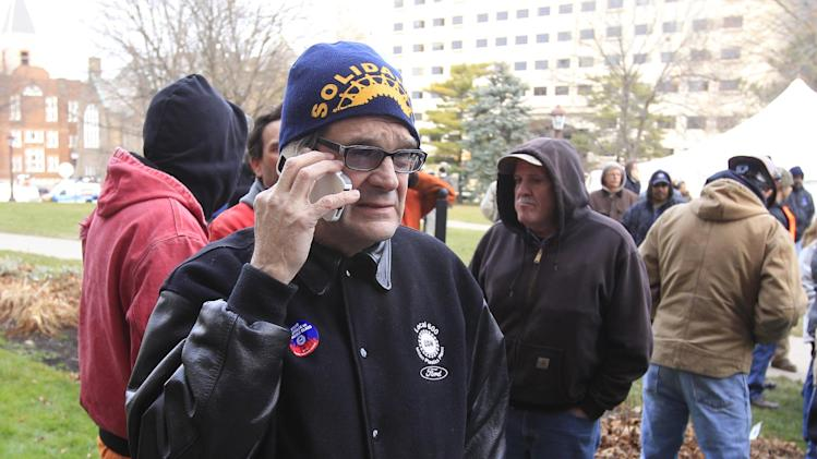 United Auto Workers President Bob King waits outside the Capitol in Lansing, Mich., Thursday, Dec. 6, 2012 as Senate Republicans introduced right-to-work legislation in the waning days of the legislative session. The outnumbered Democrats pledged to resist the proposal and said rushing it through the legislative system would poison the state's political atmosphere. (AP Photo/Carlos Osorio)