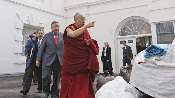 FILE - In this Feb. 18, 2010, file photo, The Dalai Lama walks out of the White House in Washington, after meeting with President Barack Obama. Obama will host Tibetan spiritual leader the Dalai Lama for a meeting on Feb. 21, 2014, the White House said, in a move that could rankle already tense relations between the U.S. and China. (AP Photo/Charles Dharapak, File)