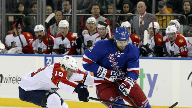 Florida Panthers' Scottie Upshall (19) battles for the puck against New York Rangers' Nick Rash during the second period of an NHL hockey game Thursday, April 18, 2013 at Madison Square Garden in New York. (AP Photo/Mary Altaffer)