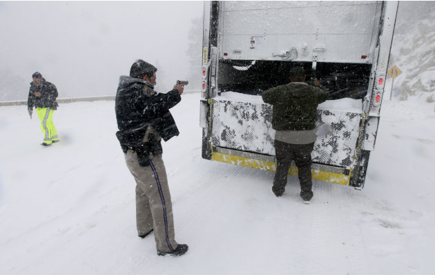 Members on the California Highway Patrol search a truck for Christopher Dorner, a former Los Angeles police officer accused of carrying out a killing spree because he felt he was unfairly fired from h