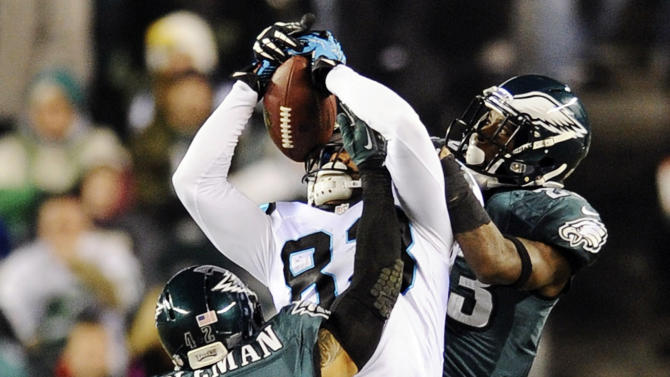 Carolina Panthers wide receiver Louis Murphy, center, pulls in a pass as Philadelphia Eagles cornerback Dominique Rodgers-Cromartie, right, and free safety Kurt Coleman defend in the second half of an NFL football game, Monday, Nov. 26, 2012, in Philadelphia. (AP Photo/Michael Perez)