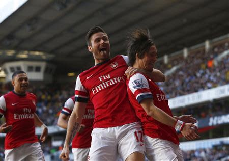 Arsenal's Rosicky celebrates his goal against Tottenham Hotspur with Giroud during their English Premier League soccer match in London