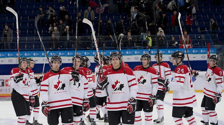 Team Canada gestures to the crowd after being defeated by Team USA in a semifinal match at the hockey world junior championships in Ufa, Russia on Thursday, Jan. 3, 2013. (AP Photo/The Canadian Press, Nathan Denette)