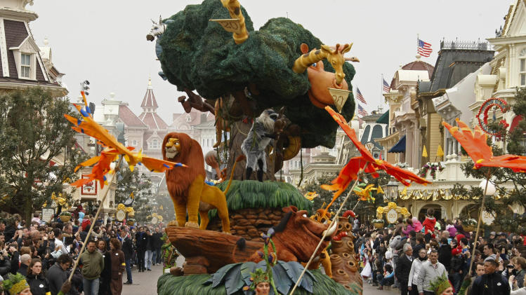 Characters from EuroDisneylandperform in Disneylands theme park in Marne-la-Vallee, east of Paris, Saturday March 31, 2012. This will mark the 20th year since Disneyland opened in Paris in 1992.(AP Photo/Michel Spingler)