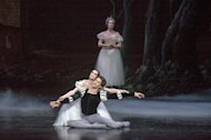 "This July 13, 2012 photo released by the Lincoln Center Festival shows Aurelie Dupont as Giselle and Mathieu Ganio as Albrecht of the Paris Opera Ballet performing in ""Giselle"", presented by Lincoln Center Festival 2012 at the David H. Koch Theater in New York. (AP Photo/Lincoln Center Festival, Stephanie Berger)"