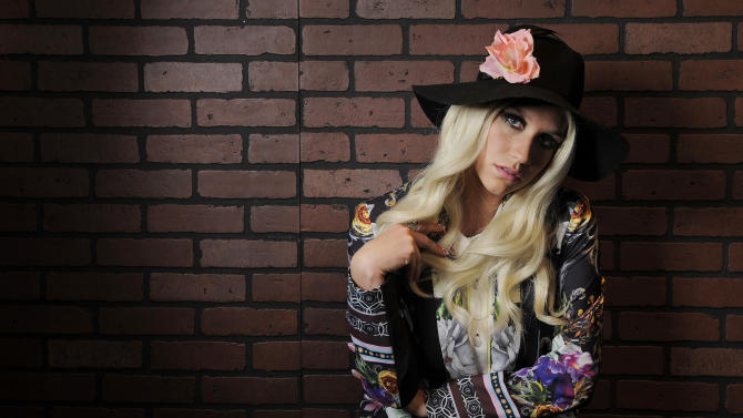 """In this Tuesday, Nov. 13, 2012 photo, singer-songwriter Ke$ha poses for a portrait in Los Angeles. Ke$ha co-wrote five songs on her newly released album """"Warrior,"""" with her mother Pebe Sebert, a singer-songwriter from Tennessee who penned """"Old Flames Can't Hold a Candle to You,"""" a hit for Dolly Parton in 1980. She says she learned about songwriting by sneaking into her mother's sessions as a child.  (Photo by Chris Pizzello/Invision/AP)"""