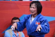 North Korea&#39;s An Kum-Ae celebrates after beating Cuba&#39;s Yanet Bermoy Acosta during their women&#39;s under-52kg final match at the London 2012 Olympic Games. The fighter continued North Korea&#39;s fine record in Olympic women&#39;s judo by winning the under-52kg division at London&#39;s ExCeL Arena