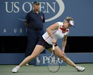 Kim Clijsters of Belgium straightens up during her match against British teen Laura Robson during their 2012 US Open match at the USTA Billie Jean King National Tennis Center in New York on August 29. Robson won 7-6 (7/4), 7-6 (7/5)