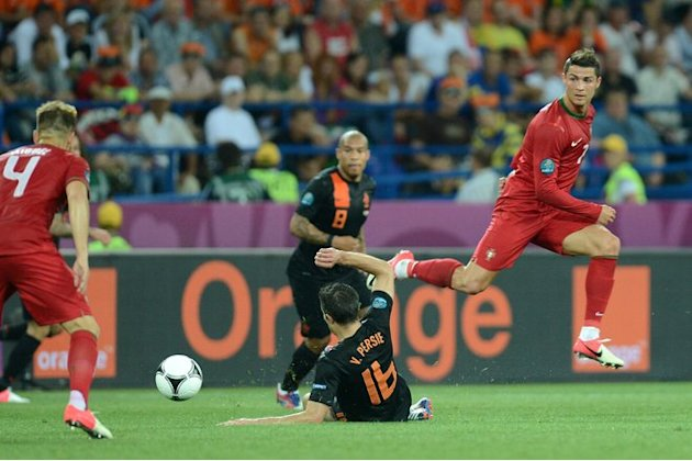 Dutch Forward Robin Van Persie (C) Tackles Portuguese Forward Cristiano Ronaldo (R)   AFP PHOTO / PATRICK AFP/Getty Images