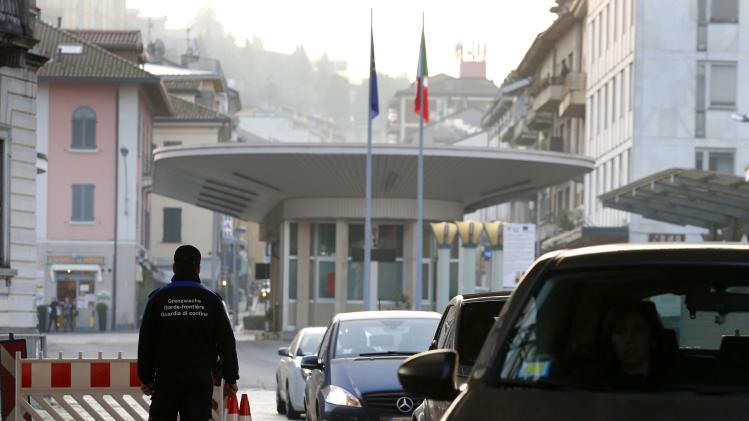 Swiss customs officer checks vehicles at the Swiss-Italian border with Como in Chiasso