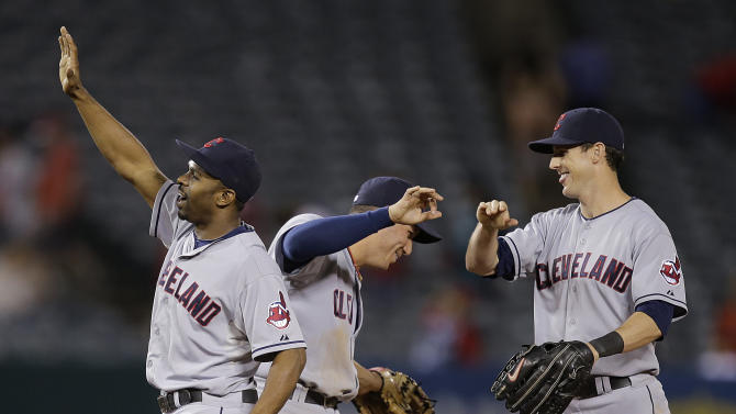 Cleveland Indians' Michael Bourn, left, Asdrubal Cabrera, center, and Drew Stubbs celebrate their team's 4-1 win against the Los Angeles Angels after a baseball game on Wednesday, Aug. 21, 2013, in Anaheim, Calif. (AP Photo/Jae C. Hong)