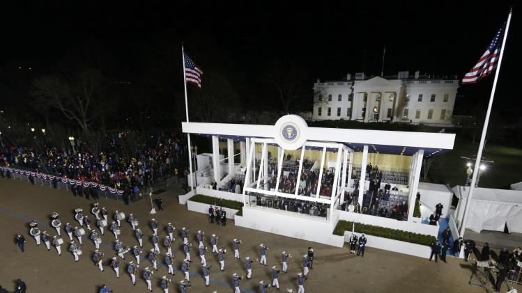 Norwich University Regimental Band, in Vermont,  perform while passing the presidential box and the White House during the Inaugural parade, Monday, Jan. 21, 2013, in Washington. Thousands  marched during the 57th Presidential Inauguration parade after the ceremonial swearing-in of President Barack Obama. (AP Photo/Charlie Neibergall )