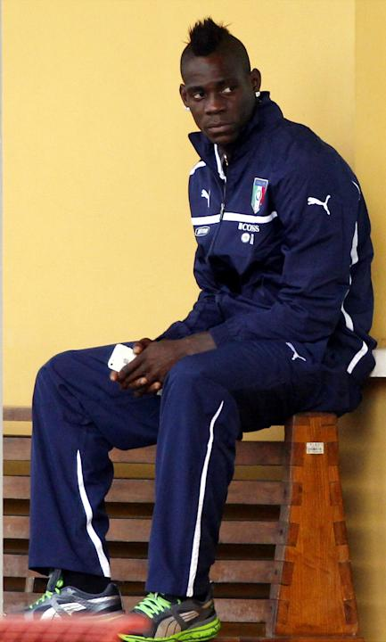 Italy's Mario Balotelli waits for the start of a training session at the Coverciano training grounds, near Florence, Italy, Monday, Oct. 7, 2013. Italy is scheduled to play a Would Cup qualifier socce