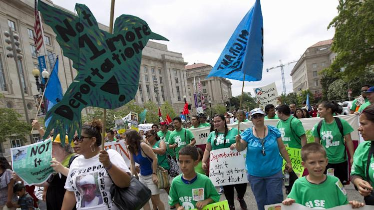 FILE - This Aug. 2, 2014 file photo shows demonstrators protesting at Freedom Plaza in Washington asking President Barack Obama to modify his deportations policies. The White House is crafting a blame-it-on-Congress legal justification to back up President Barack Obama's impending executive actions on immigration. Facing an expect onslaught of opposition, the administration plans to argue that by failing to provide enough resources to fully enforce U.S. laws, lawmakers have ceded wide latitude to White House to prioritize deportations, administration officials and legal experts said. But Republicans, too, are exploring their legal options for stopping Obama from what they've deemed an egregious presidential overstep. (AP Photo/Jose Luis Magana, File)