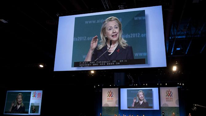 Secretary of State Hillary Rodham Clinton is seen on large video screen as she speaks at the XIX International Aids Conference, Monday, July 23, 2012, in Washington. (AP Photo/Carolyn Kaster)