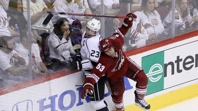 Derek Morris #53 Of The Phoenix Coyotes Spins Away From A Check By Dustin Brown #23 Of The Los Angeles Kings In The Getty Images