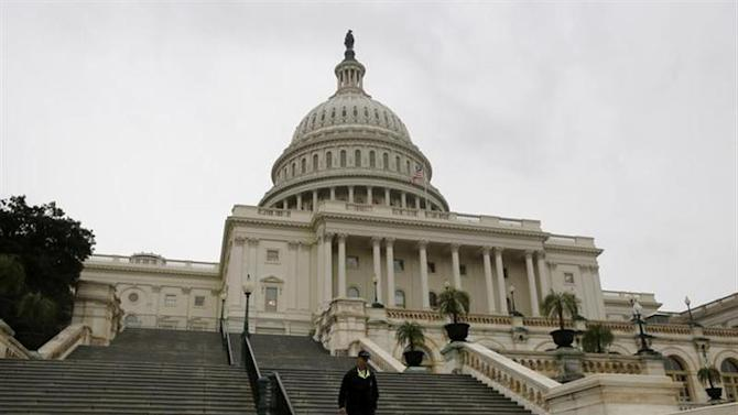 A U.S. Capitol police officer walks down the West Front steps of the U.S. Capitol in Washington October 7, 2013. REUTERS/Jason Reed