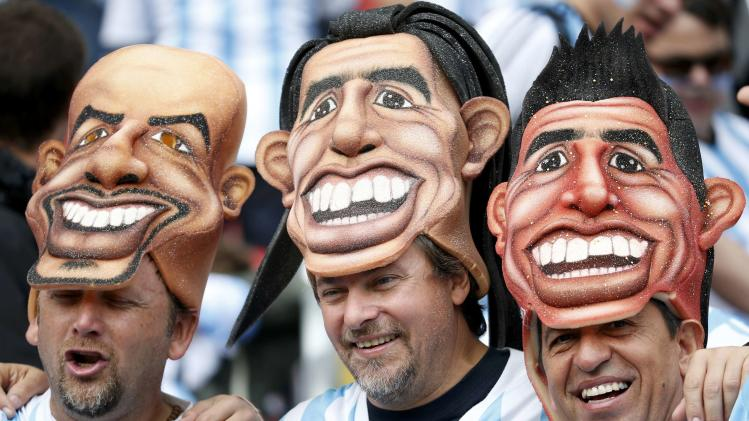 Argentinian fans wear masks as they attend the 2014 World Cup Group F soccer match against Nigeria at the Beira Rio stadium in Porto Alegre