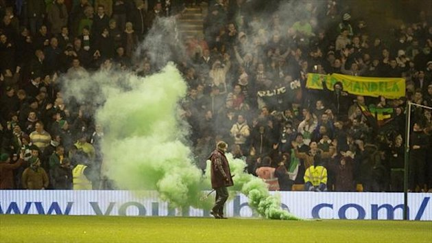 Celtic fans threw flares on to the pitch