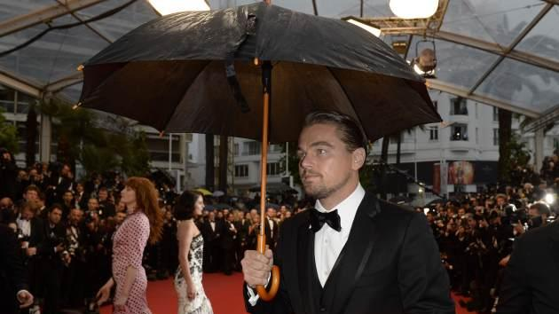 Leonardo DiCaprio holds an umbrella on May 15, 2013 as he arrives for the screening of the film 'The Great Gatsby' ahead of the opening of the 66th edition of the Cannes Film Festival in Cannes -- Getty Images