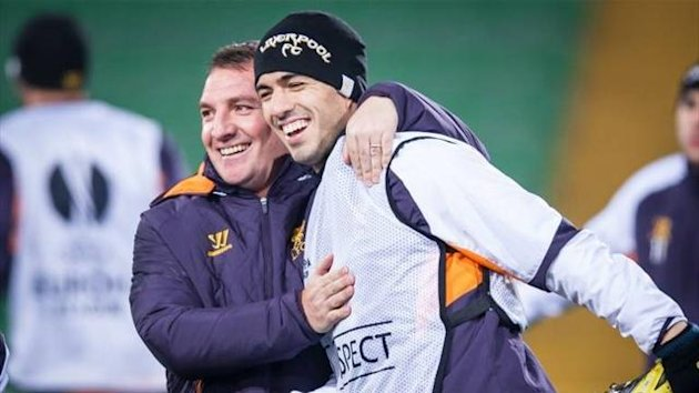 Brendan Rodgers with Luis Suarez at Liverpool (AFP)