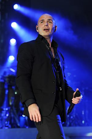 """FILE - This June 29, 2013 file photo shows Pitbull performing at the iHeartRadio Ultimate Pool Party at the Fontainebleau Hotel in Miami. Pitbull will be host for the American Music Awards on Nov. 24. A news release says the Miami rapper also will perform his song """"Timber"""" with Ke$ha during the awards show, broadcast live from Los Angeles on ABC. (Photo by Jeff Daly/Invision/AP, File)"""