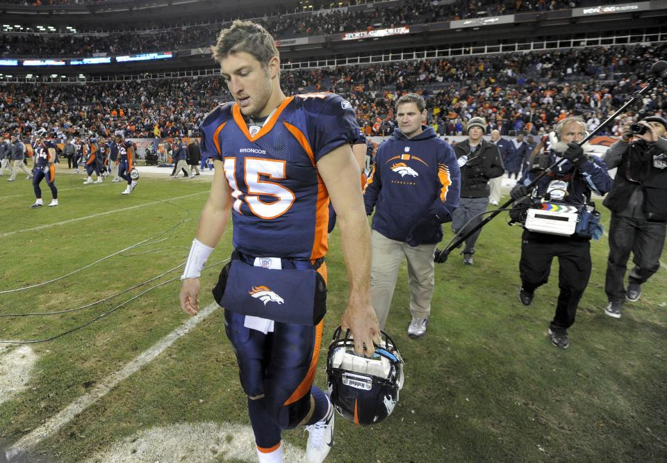 Denver Broncos quarterback Tim Tebow (15) walks off the field after the Broncos lost 7-3 to the Kansas City Chiefs in an NFL football game, Sunday, Jan. 1, 2012, in Denver.  (AP Photo/Jack Dempsey)