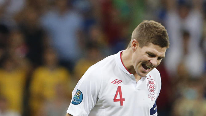 England's Steven Gerrard reacts after scoring in the penalthy shootout during the Euro 2012 soccer championship quarterfinal match between England and Italy in Kiev, Ukraine, Monday, June 25, 2012. (AP Photo/Gregorio Borgia)