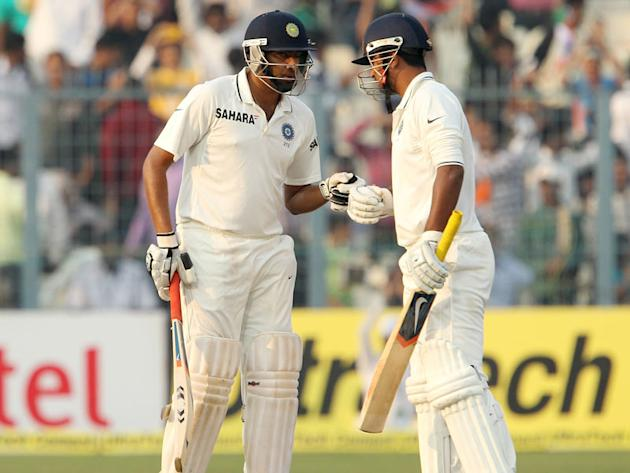 India's Ravichandran Ashwin has a word with Pragyan Ojha on Day 4 of the Eden Gardens Test match against England.