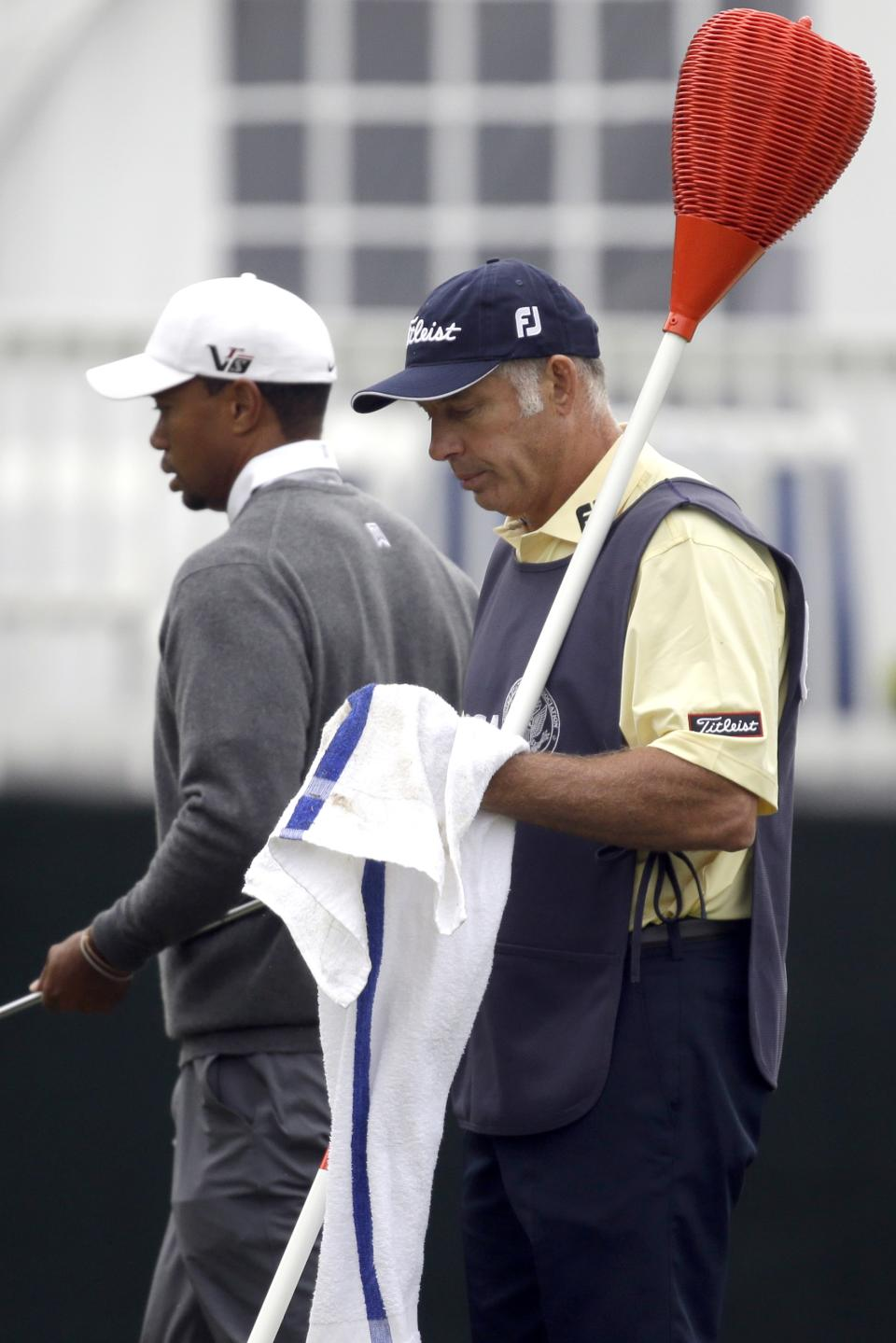 Caddie Steve Williams, right, and Tiger Woods walk on the 13th green during the first round of the U.S. Open golf tournament at Merion Golf Club, Friday, June 14, 2013, in Ardmore, Pa. (AP Photo/Morry Gash)