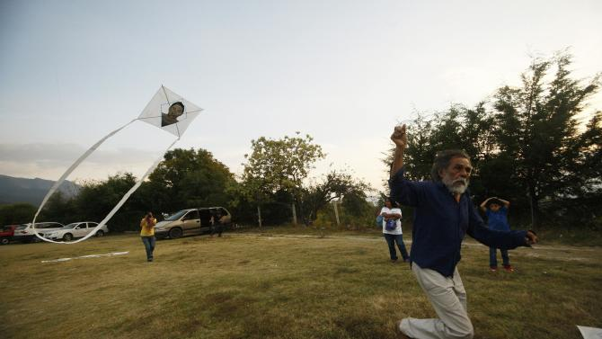 Mexican graphic artist Francisco Toledo flies kite, with a picture of one of the 43 missing students of the Ayotzinapa Teacher Training College 'Raul Isidro Burgos', at the Arts Center of San Miguel Etla