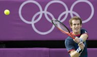 Britain's Andy Murray returns a shot to Cyprus' Marcos Baghdatis in the 3rd round men's singles tennis match at the All England Tennis Club in Wimbledon, southwest London, during the London 2012 Olympic Games. Murray won the match