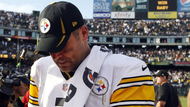 Pittsburgh Steelers quarterback Ben Roethlisberger walks off the field after a 34-31 loss to the Oakland Raiders during an NFL football game in Oakland, Calif., Sunday, Sept. 23, 2012. (AP Photo/Tony Avelar)