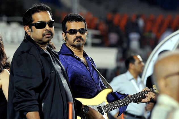 Indian Bollywood musicians and singers Shankar Mahadevan (L) and Ehsaan Noorani prepare to perform during the grand opening ceremony of the Toyota University Cricket Championship (TUCC) first match of