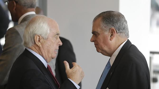 U.S. Transportation Secretary Ray LaHood, right, talks with Roger Penske after a news conference in Detroit, Friday, Jan. 18, 2013 where LaHood announced that the federal government will award $25 million toward the $140-million M-1 Rail project. The 3.3-mile streetcar line along Woodward Avenue will link the city's downtown and the cultural, medical and educational center a few miles north. (AP Photo/Carlos Osorio)