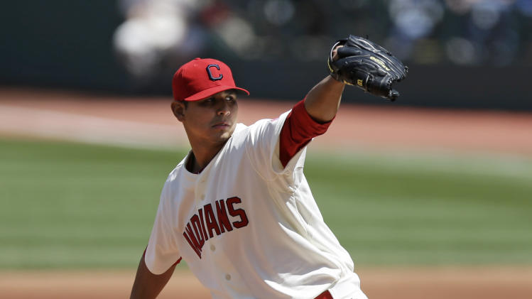 Cleveland Indians starting pitcher Carlos Carrasco delivers in the first inning of a baseball game against the Toronto Blue Jays, Sunday, April 20, 2014, in Cleveland. (AP Photo/Tony Dejak)