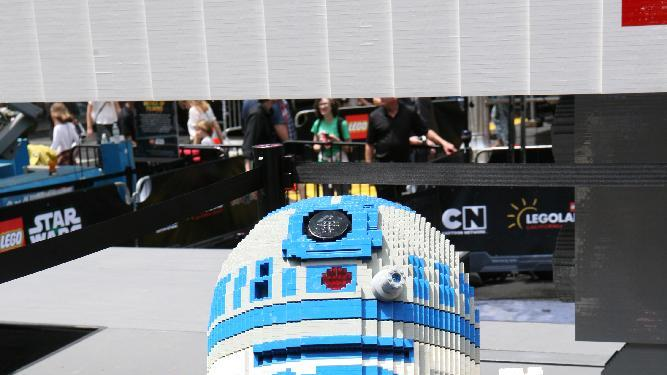 A LEGO sculpture of Star Wars R2D2 is seen after the unveiling of the world's largest LEGO Model, a 1:1 replica of the LEGO Star Wars X-wing Starfighter that took 32 Model Builders, 5.3 million LEGO bricks and over 17,000 hours to complete, in New York City's Times Square, Thursday May 23, 2013. (Amy Sussman/AP Images for The LEGO Group)