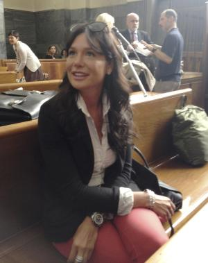 """Former dental hygienist and Lombardy regional councilor Nicole Minetti attends a hearing of a trial of three(including herself) former Italian Premier Silvio Berlusconi aides accused of procuring women for prostitution for the former premier, in Milan, Friday, June 7, 2013. Minetti, charged with recruiting prostitutes to attend Berlusconi's infamous """"bunga bunga"""" parties, testified Friday in her own defense saying she loved the then-premier and never invited anyone to attend his dinner parties. The trial is separate from one in which Berlusconi is charged with paying for sex with a minor — Karima el-Mahroug — and trying to cover it up. (AP Photo/Antonio Calanni)"""