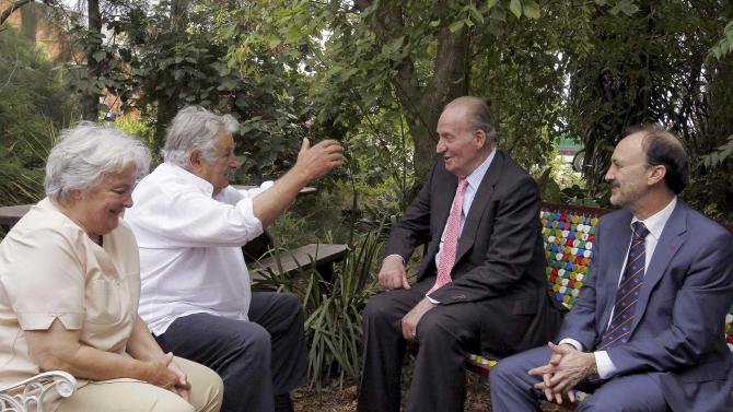 Former Uruguayan President Jose Mujica, Spanish King Juan Carlos, Uruguayan Senator Lucia Topolansky and State Secretary for Latin America and International Cooperation Manuel Gracia meet in the outskirts of Montevideo