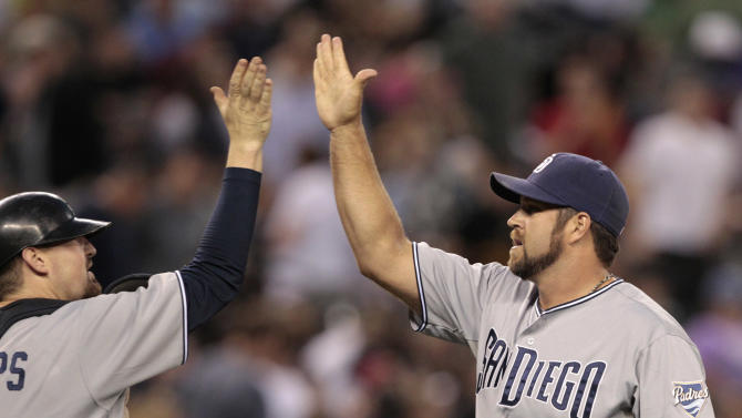 San Diego Padres closer Heath Bell, right, celebrates the team's victory with catcher Kyle Phillips over the Seattle Mariners in a baseball game Saturday, July 2, 2011, in Seattle. The Padres won 1-0. (AP Photo/Elaine Thompson)
